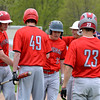 Effingham's Zac Bateman (center) is congratulated at home plate by Parker Seachrist (white helmet) after hitting a grand slam against Neoga . Lane Koenig (left), Colby Utz (49) and Blake White (23) also celebrate at home.