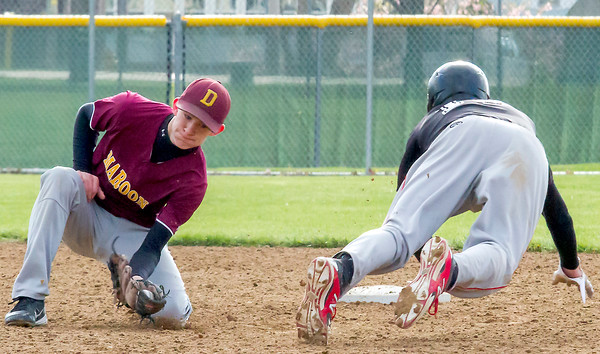 Dieterich's Charlie Thoele tries to tag Effingham's Reed Schafer at second base.