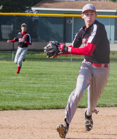 Effingham shortstop Reed Schafer eyes third base prior to his throw against Teutopolis.