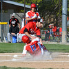 St. Anthony's Austin Kline (13) slides under a tag from Beecher City/Cowden-Herrick's Nick Miller at home while St. Anthony's James Kabbes (back) looks on at Evergreen Park.