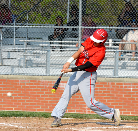 Effingham's Hudson Graham follows through on an RBI single during the Flaming Hearts' 13-2 win over Casey-Westfield.