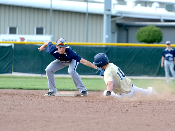 South Central shortstop Gavin Ratermann tags out Teutopolis' Devin Smith trying to steal second.