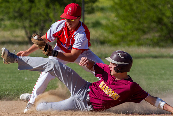 Dieterich's Callaway Campton slides towards second base but is tagged out by St. Anthony's Austin Kline. The play would be one of few highlights for the Bulldogs, who were downed 12-6.