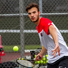 Effingham's Alessandro Boca eyes the ball before connecting with a forehand swing against St. Anthony's Andy Saba in the number one singles match. He went on to win 6-1, 6-3.