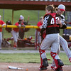 Effingham pitcher Bryce Lohman, right, and catcher Nick Bishop greet one another moments after Charleston popped out for the third and final out of Saturday's doubleheader, which the Hearts swept 10-9 and 8-7.