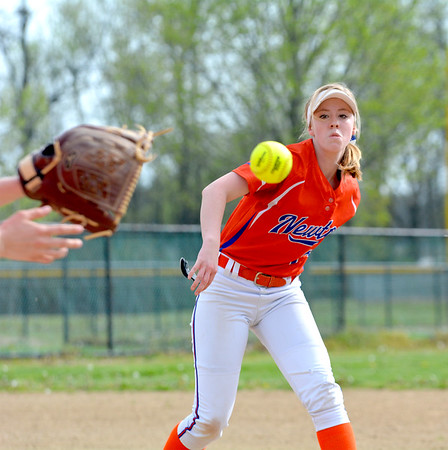 Newton pitcher Olivia Shipman watches the ball after flipping it to first baseman Taylor Smith in a game against Altamont.