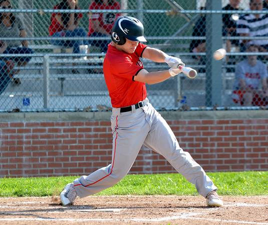 Effingham's Zac Bateman connects on a two-run double in the first inning of Effingham's 3-2 win over North Clay at Paul Smith Field.
