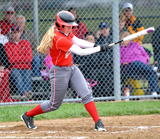 ffingham's Emma Budde connects on a base hit during the Lady Hearts' win over Nokomis.