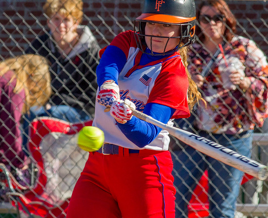 St. Anthony's Jenna Woltman makes prepares to make contact. Woltman led the Bulldog effort against Neoga, not only with solid play behind the plate but also by going 2-for-3 on the day in a 4-2 conference win.