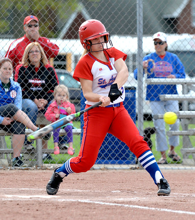 St. Anthony's Katie Kabbes connects on an RBI single against St. Elmo/Brownstown at St. Anthony High School.
