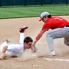 Neoga's Justin Yurs slides into third base as Effingham's Lane Koenig applies the tag. Yurs was safe on the play and scored to give Neoga a lead, but Effingham rallied to take a 13-3 win.