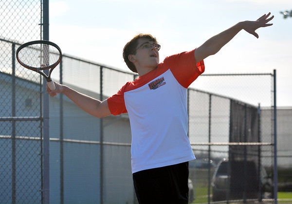 Effingham's Nick Katz prepares to serve during a home match against Mattoon.