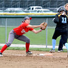 Effingham second baseman Jenna Wright covers first base on a bunt and retires Cumberland's Danae Sowers (11) on the play.