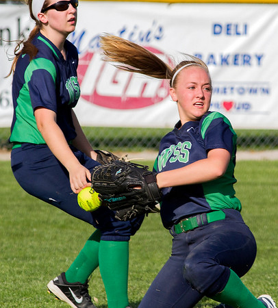 Left fielder Katrina Davis, left, backs up center fielder Carson Cole after she missed a diving catch in the bottom of the third inning. Casey-Westfield scored seven runs in the third and defeated Windsor/Stew-Stras 8-1.