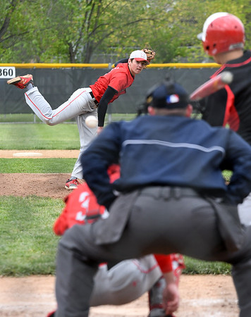 Effingham's Brent Beals delivers a pitch to a Mt. Zion batter during game one of a doubleheader at Paul Smith Field. <br /> Chet Piotrowski Jr./Piotrowski Studios