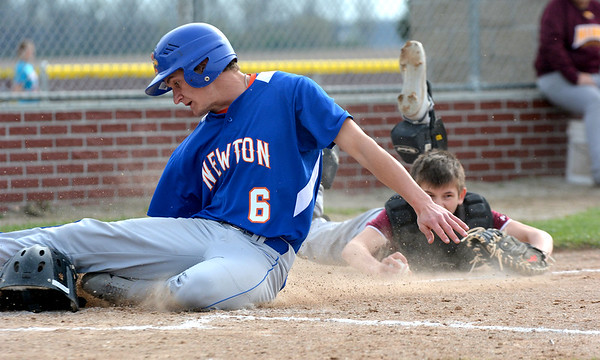Newton's Tim Weber slides into home plate just ahead of Dieterich catcher Devin Flach (laying, background) during the Eagles' win over the Movin' Maroons.
