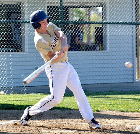 Teutopolis' Carson Hartke swings at a pitch during the first inning, a pitch he would homer on in a 15-8 win over South Central. Both Hartke and teammate Jason Kenter homered twice in the win for the Wooden Shoes.