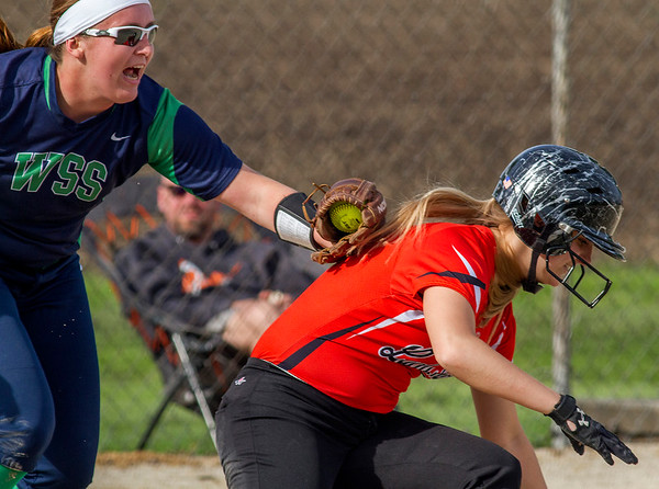 Windsor/Stew-Stras' Calla Roney, left, tags out Altamont's Keidron Duckwitz between third and home plate during the top of the third inning. The Hatchets had a similar rundown in the second inning and went on to win 3-1.