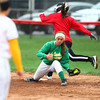 4-13-13<br /> Eastern and Taylor softball<br /> Eastern's first baseman Lizzy Mavrick catches the throw from the pitcher to get the Taylor runner out.<br /> KT photo | Kelly Lafferty