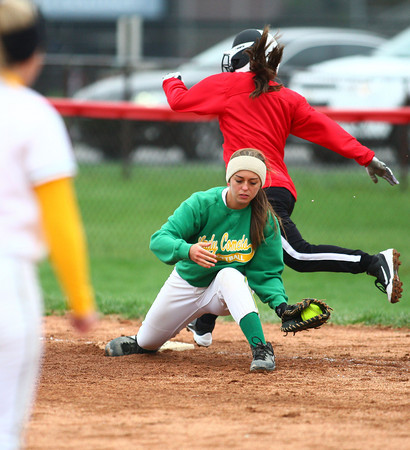 4-13-13<br /> Eastern and Taylor softball<br /> Eastern's first baseman Lizzy Mavrick catches the throw from the pitcher to get the Taylor runner out.<br /> KT photo   Kelly Lafferty