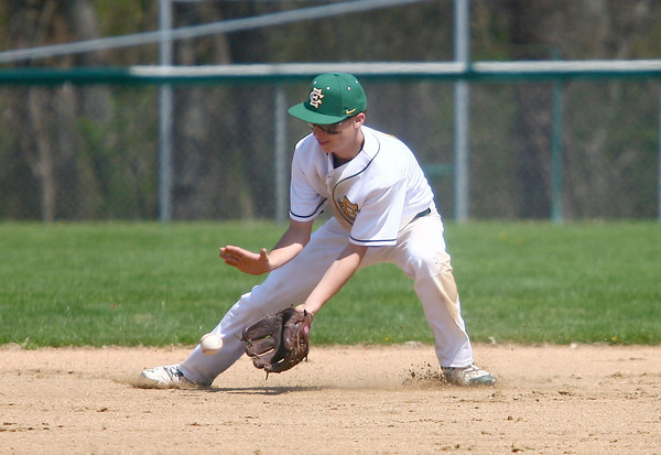 4-26-14<br /> Eastern vs. South Adams baseball<br /> Eastern's Zach Robinson scoops up the ball.<br /> Kelly Lafferty   Kokomo Tribune