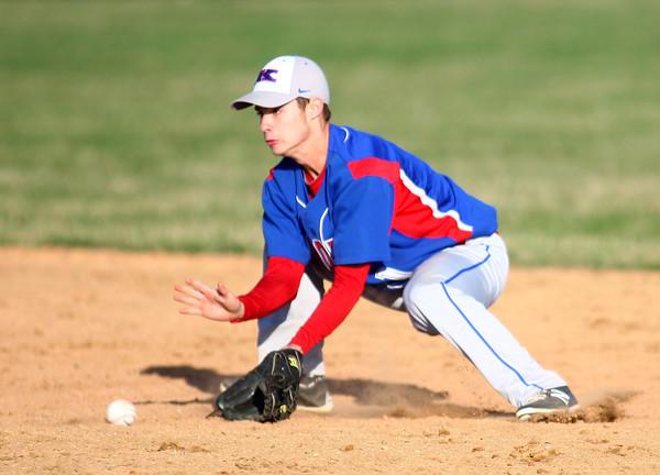 4-16-14<br /> Kokomo vs. Western baseball<br /> Kokomo's Jared Dill scoops up the ball.<br /> Kelly Lafferty | Kokomo Tribune
