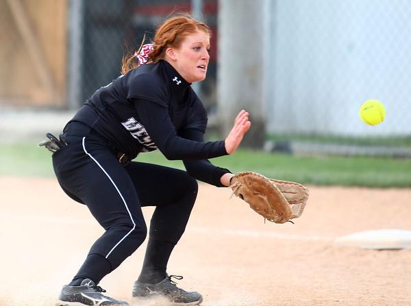4-24-14<br /> Western vs. Northwestern softball<br /> Western's Caitlyn O'Neal scoops up the ball.<br /> Kelly Lafferty   Kokomo Tribune