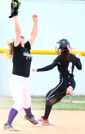 4-24-14<br /> Western vs. Northwestern softball<br /> Northwestern's Crystal Metz catches the throw to first and gets Western's Evie Glover out.<br /> Kelly Lafferty | Kokomo Tribune