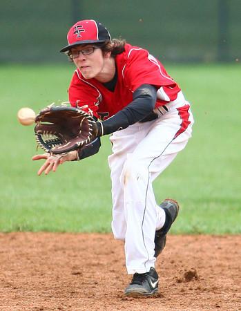 4-29-14<br /> Western vs. Taylor baseball<br /> Taylor's Austin Douglas catches the ball for an out.<br /> Kelly Lafferty | Kokomo Tribune