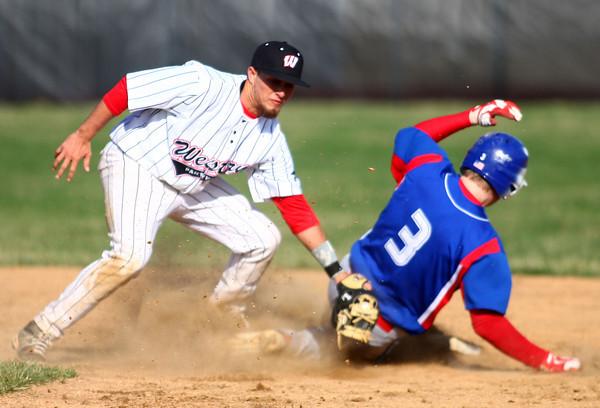 4-16-14<br /> Kokomo vs. Western baseball<br /> Kokomo's Bo Baker slides to second safely before Western's Evan Warden can tag him.<br /> Kelly Lafferty | Kokomo Tribune