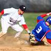4-16-14<br /> Kokomo vs. Western baseball<br /> Kokomo's Bo Baker slides to second safely before Western's Evan Warden can tag him.<br /> Kelly Lafferty   Kokomo Tribune