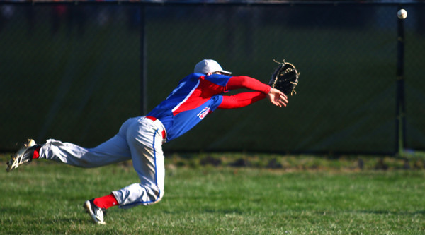 4-16-14<br /> Kokomo vs. Western baseball<br /> Kokomo's Bo Baker lunges for the ball.<br /> Kelly Lafferty | Kokomo Tribune