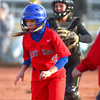 4-1-14<br /> Kokomo vs Lebanon softball<br /> Kokomo's Alexis Clark gets caught between third base and home and gets out.<br /> KT photo | Kelly Lafferty