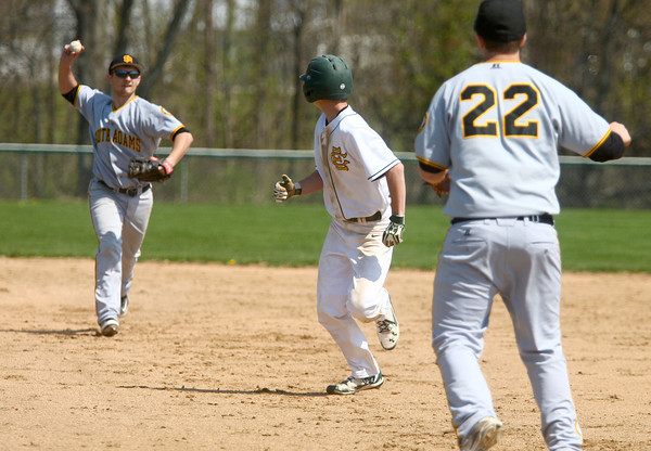 4-26-14<br /> Eastern vs. South Adams baseball<br /> Eastern's Zach Robinson gets caught in between first and second and gets out by South Adams' Collin Affolder and Dakota Pugsley.<br /> Kelly Lafferty | Kokomo Tribune