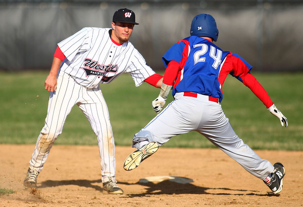 4-16-14<br /> Kokomo vs. Western baseball<br /> Western's Evan Warden gets Kokomo's Chase Pearce out on second.<br /> Kelly Lafferty | Kokomo Tribune