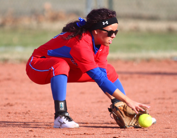 4-1-14<br /> Kokomo vs Lebanon softball<br /> Kokomo's Sarah Haughn scoops up the ball.<br /> KT photo | Kelly Lafferty
