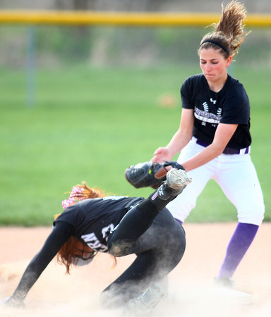 4-24-14<br /> Western vs. Northwestern softball<br /> Western's Carley O'Neal is safe at second after Sophia Beachy tries to get her out.<br /> Kelly Lafferty | Kokomo Tribune