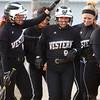 4-24-14<br /> Western vs. Northwestern softball<br /> Western's Jenna Wiechmann is congratulated by her teammates at home base after she hit a home run.<br /> Kelly Lafferty | Kokomo Tribune