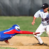 4-16-14<br /> Kokomo vs. Western baseball<br /> Kokomo's Bo Baker gets picked off on second after Western's Evan Warden makes the catch.<br /> Kelly Lafferty | Kokomo Tribune