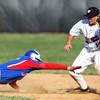 4-16-14<br /> Kokomo vs. Western baseball<br /> Kokomo's Bo Baker gets picked off on second after Western's Evan Warden makes the catch.<br /> Kelly Lafferty   Kokomo Tribune