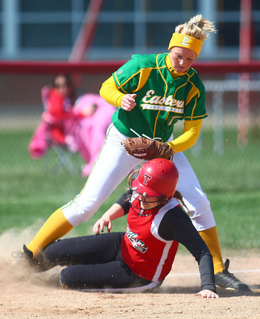 4-19-14<br /> Eastern vs. Taylor softball<br /> Taylor's McKenna Deckard gets caught running between second and third before Eastern's Abby Oyler gets her out at third.<br /> Kelly Lafferty | Kokomo Tribune