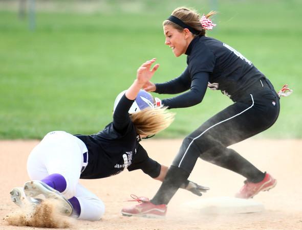 4-24-14<br /> Western vs. Northwestern softball<br /> Western's Evie Glover gets Northwestern's Kaitlyn Kennedy out at second.<br /> Kelly Lafferty   Kokomo Tribune