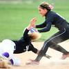 4-24-14<br /> Western vs. Northwestern softball<br /> Western's Evie Glover gets Northwestern's Kaitlyn Kennedy out at second.<br /> Kelly Lafferty | Kokomo Tribune