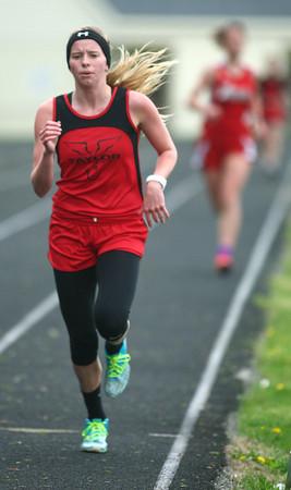 4-30-14<br /> Taylor track & field<br /> Cami Hansen in the 1600 M run<br /> Kelly Lafferty | Kokomo Tribune