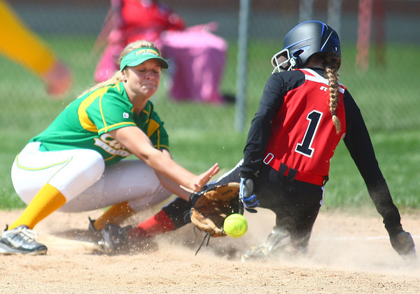 4-19-14<br /> Eastern vs. Taylor softball<br /> Taylor's Savannah Delgado slides safely to third before Eastern's Quinlyn Hochstedler catches the ball.<br /> Kelly Lafferty | Kokomo Tribune
