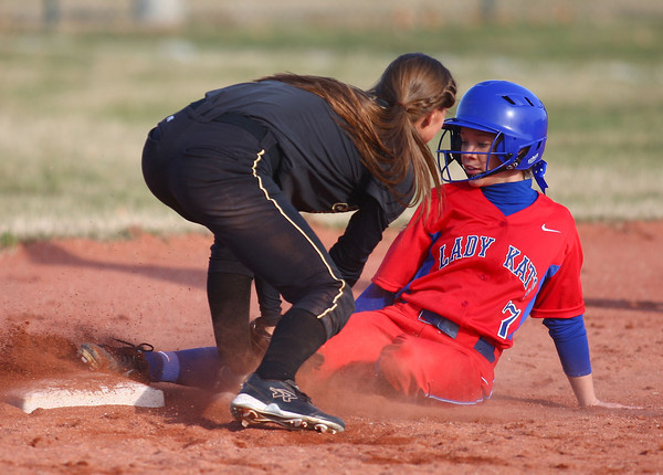 4-1-14<br /> Kokomo vs Lebanon softball<br /> Kokomo's Alexis Clark slides safely to second base as Lebanon's Brooke Montgomery tries to get her out.<br /> KT photo   Kelly Lafferty
