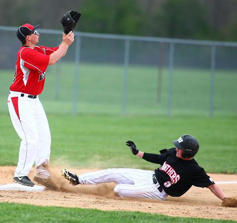 4-29-14<br /> Western vs. Taylor baseball<br /> Western's Austin Taylor slides to third safely as Taylor's Nick Barnett waits for the throw.<br /> Kelly Lafferty | Kokomo Tribune
