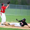 4-29-14<br /> Western vs. Taylor baseball<br /> Western's Austin Taylor slides to third safely as Taylor's Nick Barnett waits for the throw.<br /> Kelly Lafferty | Kokomo Tribune