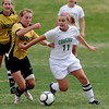 "Kylie Fischer, right, of Niwot, tries to keep the ball away from Stella Norman of Arapahoe.<br /> For more photos of the game, go to  <a href=""http://www.dailycamera.com"">http://www.dailycamera.com</a><br /> Cliff Grassmick / April 14, 2012"