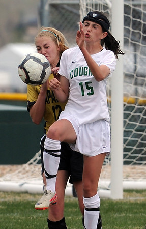 "Maria Fayeulle (15) of Niwot, gets position on Stacey Lukasiewicz of Arapahoe on Saturday.<br /> For more photos of the game, go to  <a href=""http://www.dailycamera.com"">http://www.dailycamera.com</a><br /> Cliff Grassmick / April 14, 2012"